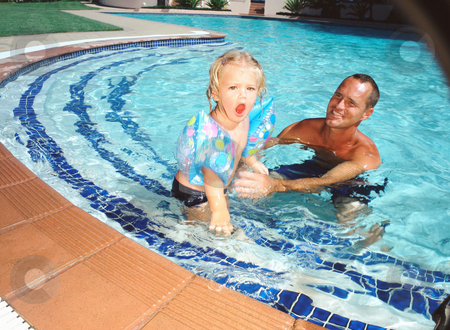 Adult and child in pool stock photo, Adult and child in pool by Mpixis World