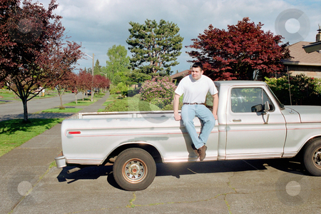 MPIXIS550177 stock photo, Man sitting on pick-up truck by Mpixis World