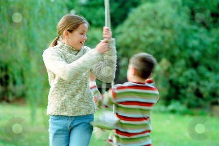 MPIXIS550475 stock photo, Kids playing on a swing by Mpixis World
