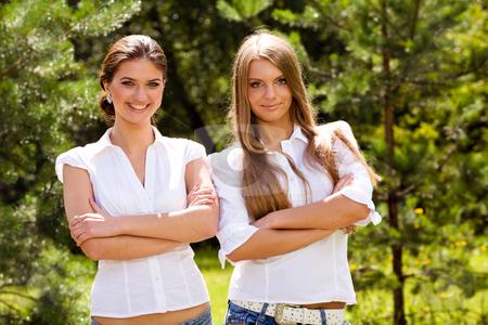 Portrait of two lovely girlfriends  stock photo, Portrait of two lovely girlfriends in summer park by Vitaly Sokolovskiy