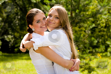 We are inseparable lovely girlfriends  stock photo, Two inseparable lovely girlfriends in summer park by Vitaly Sokolovskiy