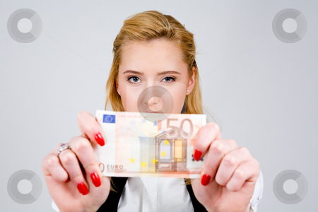 Woman with fifty euros stock photo, Young blond woman holding fifty euro by Vitaly Sokolovskiy