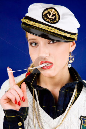 Cool young woman with chewing gum stock photo, Blond young woman with chewing gum by Vitaly Sokolovskiy