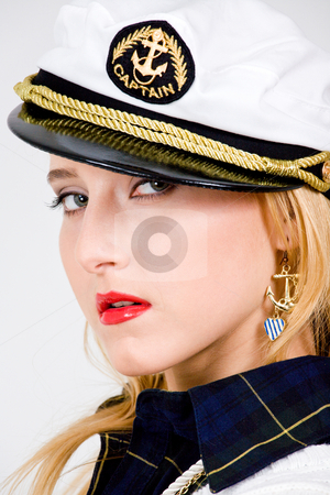 Cool blond young woman  stock photo, Blond young woman in a sea peak-cap by Vitaly Sokolovskiy