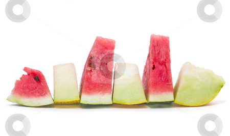 Melon slices stock photo, Melon slices isolated on white background by Adrian Costea
