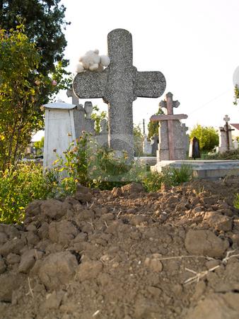 Cross stock photo, Teddy bear on a cross in cemetery by Adrian Costea
