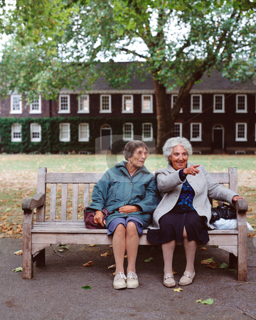 MPIXIS551050 stock photo, Senior women sitting on a wooden bench by Mpixis World