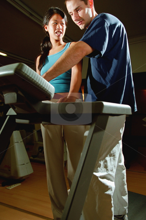MPIXIS564014 stock photo, Fitness instructor adjusting gym equipment by Mpixis World
