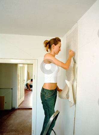 Woman on ladder painting stock photo, Couple decorating house by Mpixis World