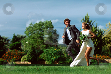 MPIXIS555038 stock photo, Newlyweds running in field by Mpixis World