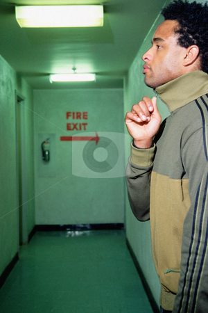 MPIXIS580010 stock photo, Young man near fire exit sign by Mpixis World