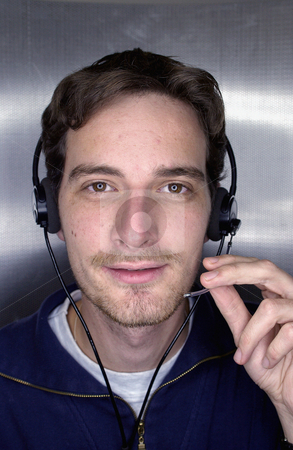 MPIXIS585002 stock photo, Young man wearing a telephone headset by Mpixis World