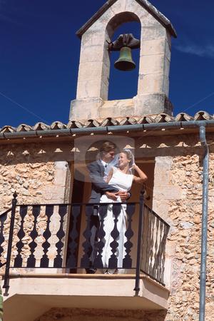 Wedding stock photo, Newlyweds on balcony by Mpixis World