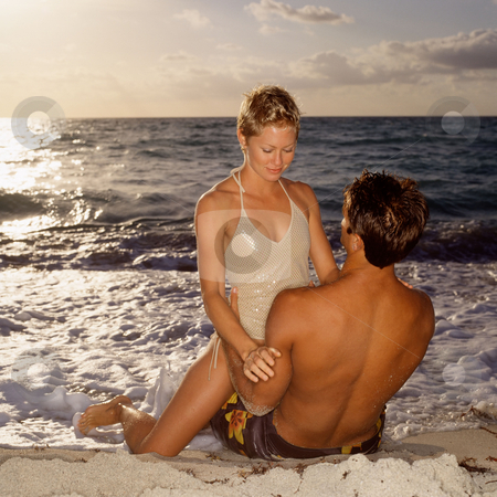 MPIXIS550573 stock photo, Couple hugging on beach by Mpixis World