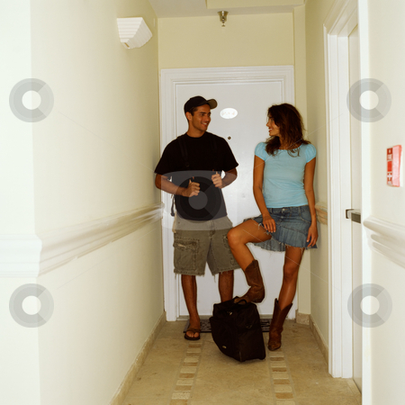 Young couple in hotel room hallway stock photo, Young couple in hotel by Mpixis World