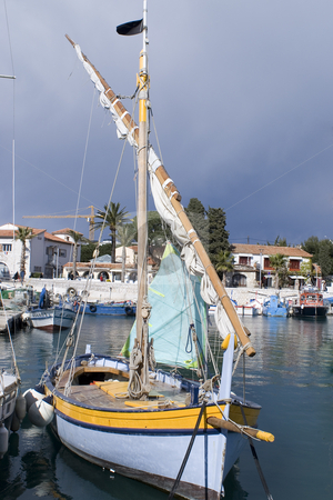 Old sailing boat stock photo, Traditional sailing boat in French Riviera. by Serge VILLA
