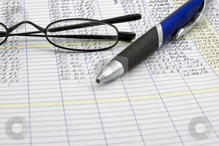 Accounting Ledger stock photo, Accounting ledger with glasses and pen by Robert Cabrera