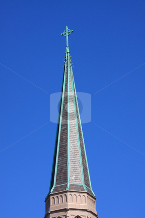 Church Steeple stock photo, Church steeple with cross on blue sky background. by Steve Stedman