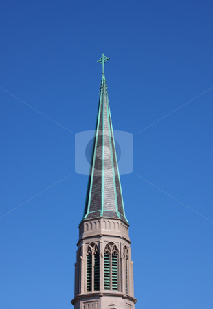 Church Spire stock photo, Church steeple with a blue sky background. by Steve Stedman