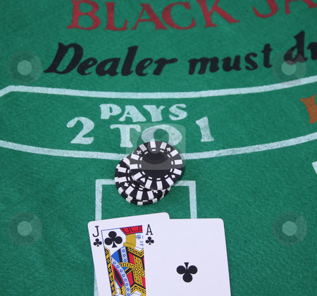 Winning Blackjack Hand stock photo, Blackjack and a stack of chips on a felt background by Steve Stedman