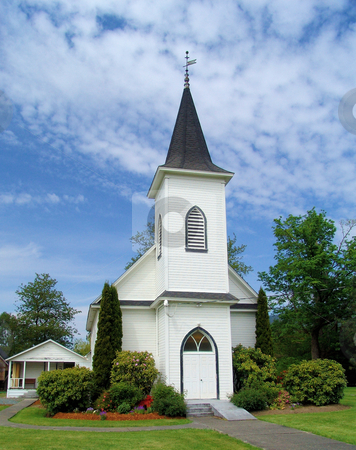 White Church stock photo, Front view of a country church with blue sky and light fluffy clouds. by Steve Stedman