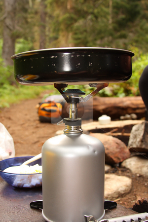 Camp Kitchen stock photo, Camp stove with flame and a frying pan. by Steve Stedman