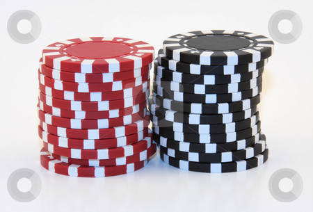 Stacks of Black and Red Poker Chips stock photo, 2 stacks of black and red poker chips isolated. by Steve Stedman