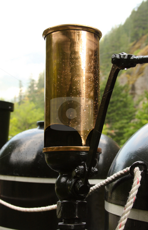 Steam Train Whistle stock photo, Brass steam train whistle in the rain. by Steve Stedman