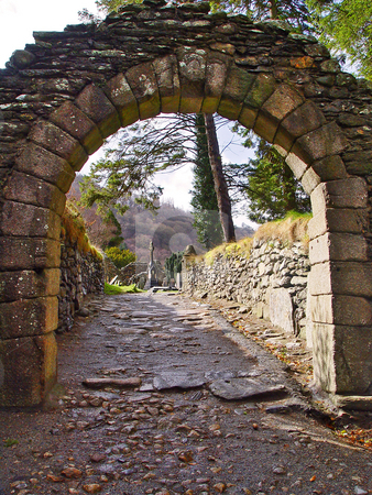 Cemetery gate stock photo, Entry gate of the cemetery of Glendalough, Wicklow Mountains, Ireland by Emmanuel Keller