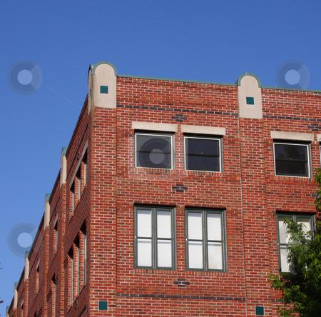 Brick Building Blue Sky stock photo, Brick Building Corner with Blue Sky background by Steve Stedman