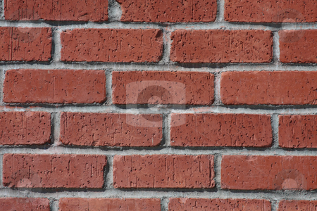 Brick and Mortar Wall stock photo, A wall of red bricks with white mortar. by Steve Stedman