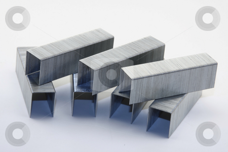 Large Staples stock photo, Several sets of large staples on a white background. by Steve Stedman