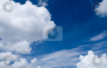 Blue Sky and cluds Background stock photo, Rich blue Sky and clouds background by Robert Cabrera