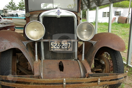 1930 Chevrolet stock photo, This old 1930 Chevrolet has seen better days and waits for a new owner. by Dennis Thomsen