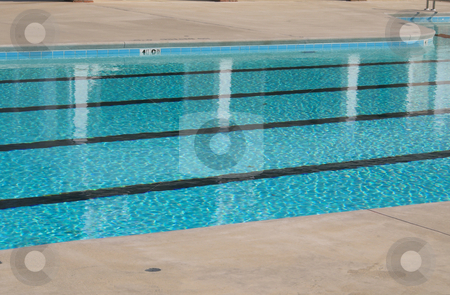 Swimming Pool stock photo, A private swimming pool on a hot summers day. by Robert Byron