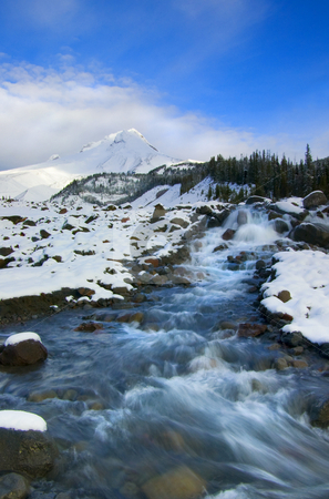 Mt. Hood Winter stock photo, Mt. Hood with the White River flowing down in front on a cold January day. by Mike Dawson