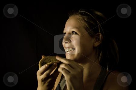 Teenage Girl Eating Cookie stock photo, Teenage Girl Eating Cookie by Patrick Kay