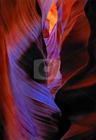 Faces of the Desert stock photo, A glimmer of light illuminates the confines of an Arizona slot Canyon, showing the faces of the Desert. by Mike Dawson