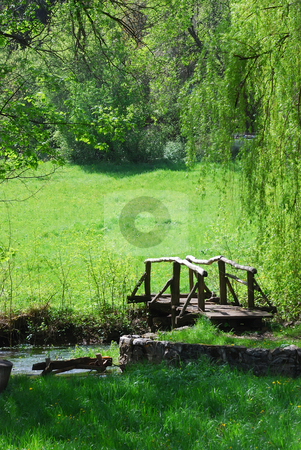 Wooden bridge stock photo, Small wooden bridge on a creek in a countryside by Ivan Paunovic