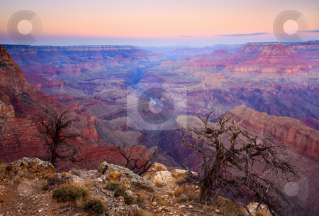 Desert Glow stock photo, The glow of a new day warms the cold confines of the Grand Canyon on a crisp autumn day. The Colorado river hides at the bottom of the canyon. by Mike Dawson