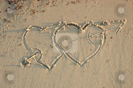 Hearts in a sand stock photo, Two hearts with an arrow in a sand by Ivan Paunovic