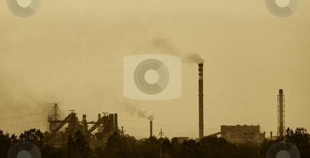 Plant stock photo, Sepia toned photo of a factory polluting air by Ivan Paunovic
