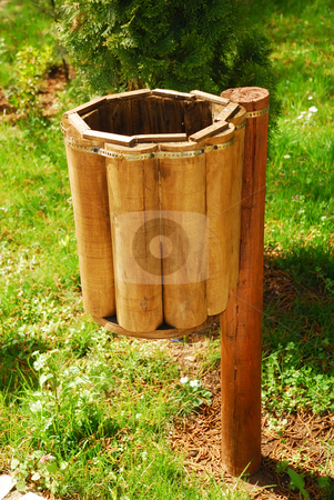 Empty trash can stock photo, An empty wooden trash can in a green surrounding by Ivan Paunovic