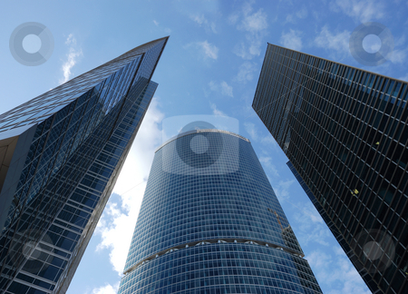 Skyscrapers stock photo, A view on a three skyscrapers above by Ivan Paunovic