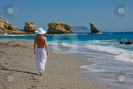 Woman walking on beach stock photo, Summer Kiss! by John Tsilidis