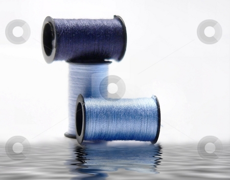 Isolated object stock photo, Spools of thread isolated on white with reflection by Perry Correll