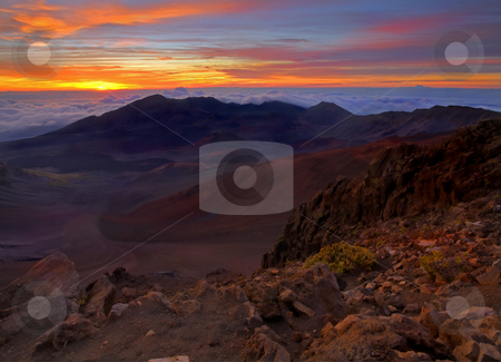 Alien Sunrise stock photo, A 3AM wakeup is needed to get this view of the sun rising over 10,000 foot Haleakala on the island of Maui. An Alien landscape created by the now dormant volcano over 200 years ago. by Mike Dawson