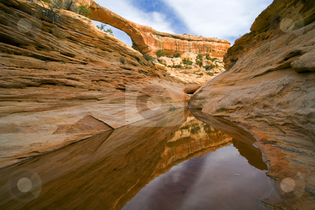 Owachomo Reflected stock photo, Owachomo Natural Bridge in Natural Bridges National Momument in Utah. by Mike Dawson