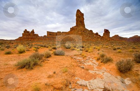Reaching for the Heavens stock photo, An Entrada Sandstone pillar in the Valley of the Gods In Utah seemingly reaching skyward. by Mike Dawson