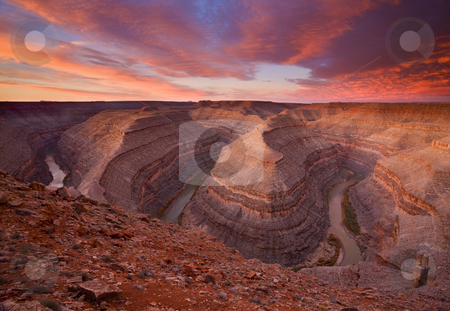 The Curves of Dawn stock photo, Goosenecks State PArk at Sunrise on a November morning. The San Juan River covers 5 miles total while moving West only 1 mile as it bends back and forth through the sandstone of Southern Utah by Mike Dawson